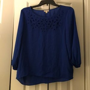 Sheer royal blue top with flower cutouts
